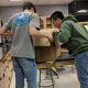 Students opening Box of tools to Study the Colorado River provided by the Student Research Foundation