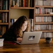 female high school student doing homework